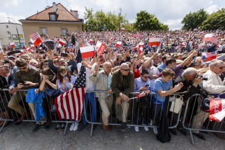 Polish crowd listening to President Trump's speech in Warsaw